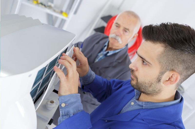 man repairing a DICOM CD burner